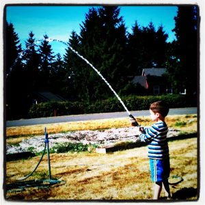 50-outside-activities-with-kids-playing-with-the-hose